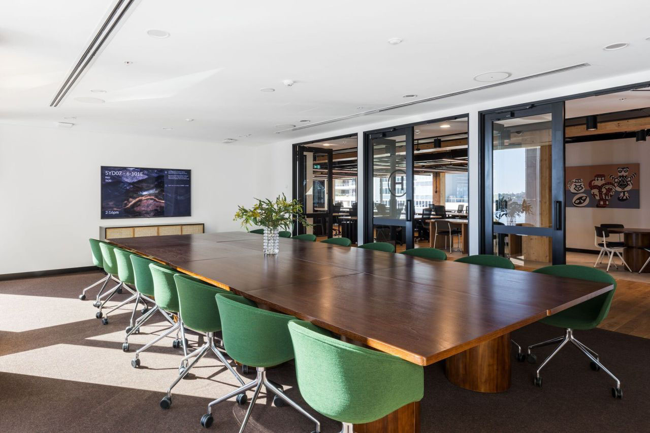 WeWork office meeting room with LED display screen
