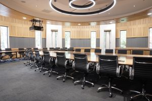 Office boardroom audio visual including ceiling speakers and projector